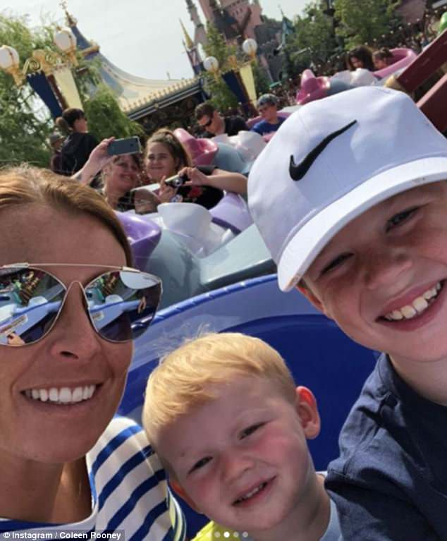 Having fun: Coleen joined sons Kai (R) and Kit on some of the fun rides at the theme park
