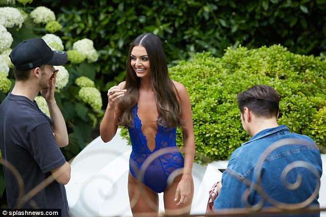 Working it: Love Island's Kendall Rae-Knight posed in an electric blue plunging lingerie on shoot in London on Sunday after leaving the show