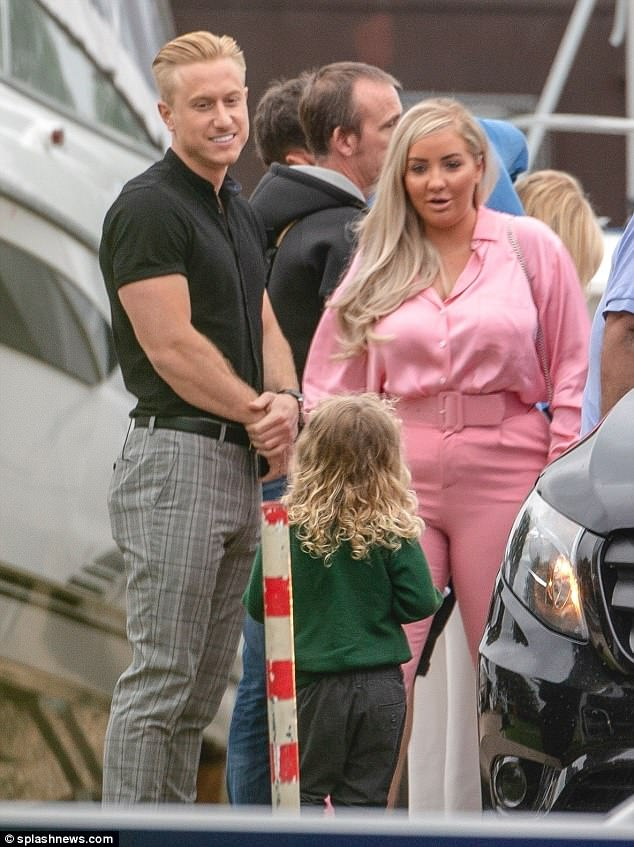 Chin wag: Kris beamed down at Katie's son Jett as they chatted with another of her friends, clad in bright pink