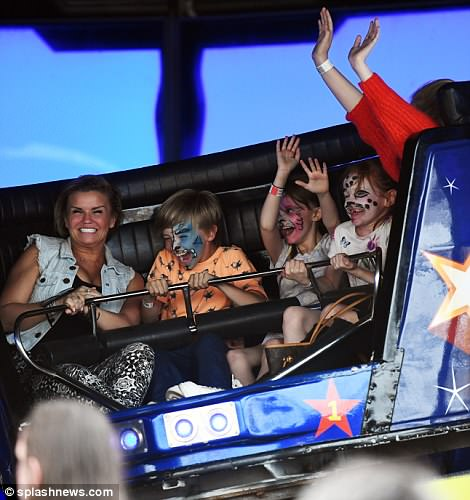 Doting mother: Kerry is known to frequently take her children on fun-filled excursions during their time off school, with the star treating her eldest daughters Lilly-Sue and Molly, 16 - who she shares with Brian McFadden - to Thorpe Park just two years ago