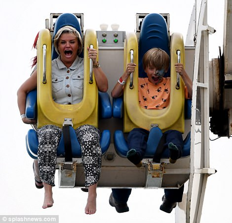 Up, up, and away! Kerry made a series of hilariously animated faces as she enjoyed another lively ride with her son Maxwell