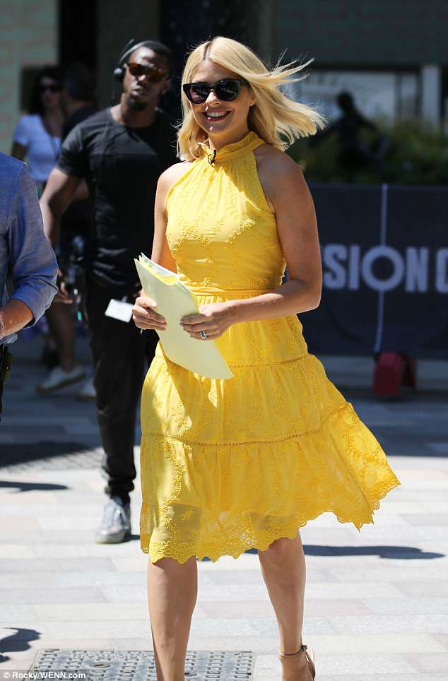 Smiles: Holly appeared in great spirits as she flaunted her natural glow in the radiant ensemble