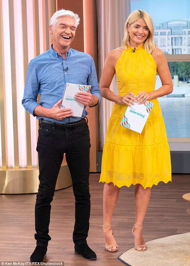 Cracking up: Holly's co-host Phil's penchant for an innuendo or two has left the presenter cracking up once again - this time over a Kelly Brook gardening segment