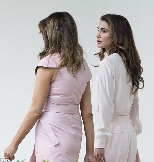 Melania and Queen Rania chatted while they walked behind their husbands