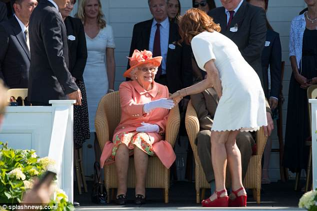 The Queen, left, had a broad smile when introduced to Hollywood star Susan Sarandon