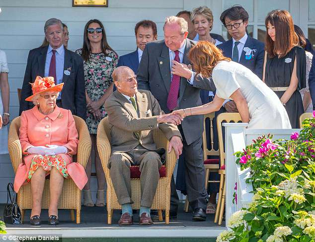 The Duke, centre, seemed not to recognise the renowned Hollywood star, right