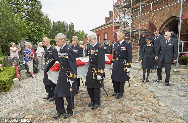 Paying their respects: Well-wishes watched to see the coffin carried out of the church as mourners followed behind