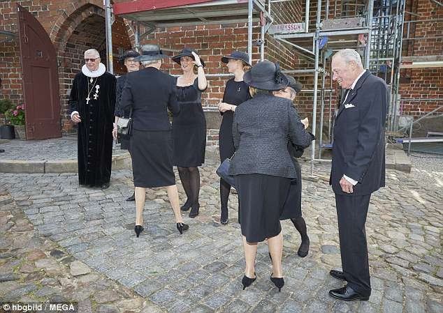 The family also made time to catch up as they stood outside the church after the service