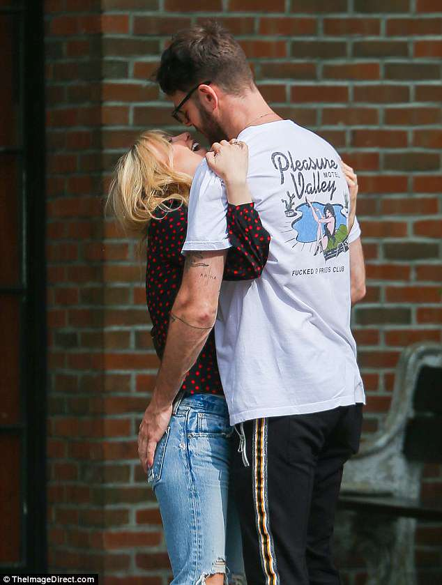 So in love:Alex Paul of The Chainsmokers and his girlfriend Katelyn Byrd were spotted kissing and cuddling on the sidewalk in New York City on Sunday