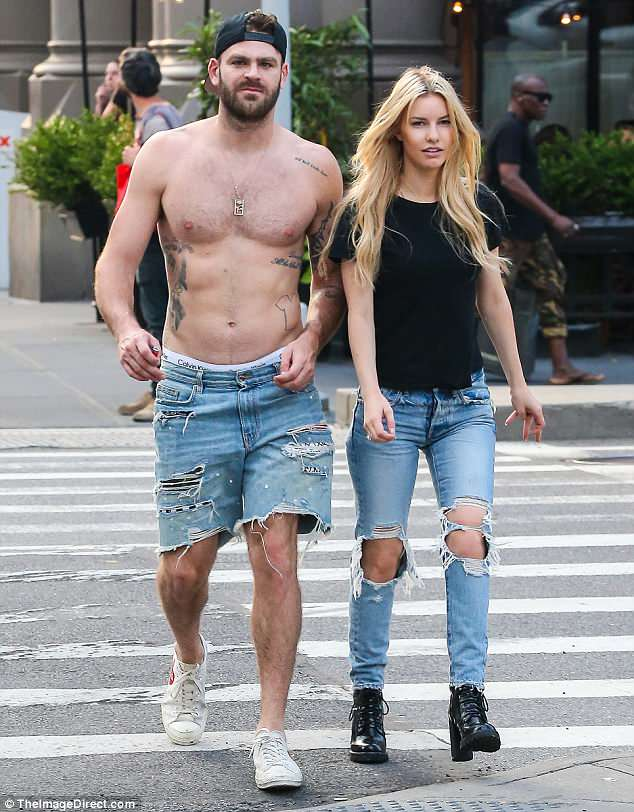 Body beautiful: Alex showed off his ripped torso and tattoos when he opted to go topless while out with Katelyn in NYC on Thursday