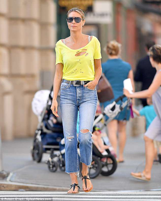 So glamorous:The statuesque supermodel hung up her heels in favour of stylish sandals as she made the streets of the Big Apple her personal catwalk