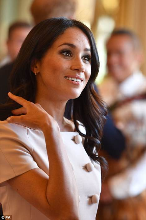 Royal-watchers noted that Meghan was sporting a new hair style, wearing her hair in barrel tonged curls