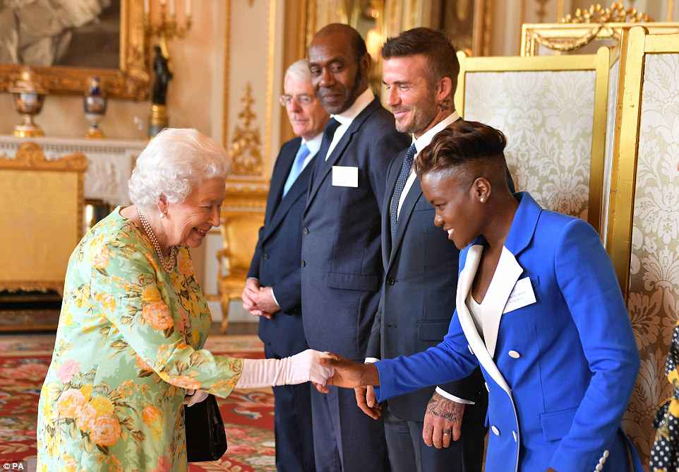 The Queen welcomes guests including (L-R) Sir John Major, Sir Lenny Henry, David Beckham and Nicola Adams.Tonight's reception is the Queen and Meghan's second joint engagement in as many weeks, after they travelled to Cheshire together