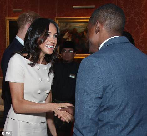 Duchess on duty: She looked animated as she had a private conversation with one of the attendees