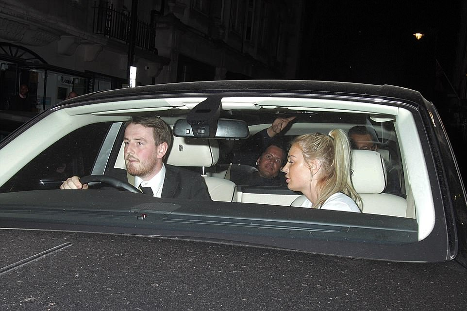 Ms Rowley jumped into the front passenger seat of the chauffeur-driven car and Stunt gestured to photographers as they left