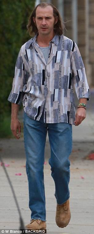 Dressed for the decade: The star teamed his jeans with an Eighties style shirt.