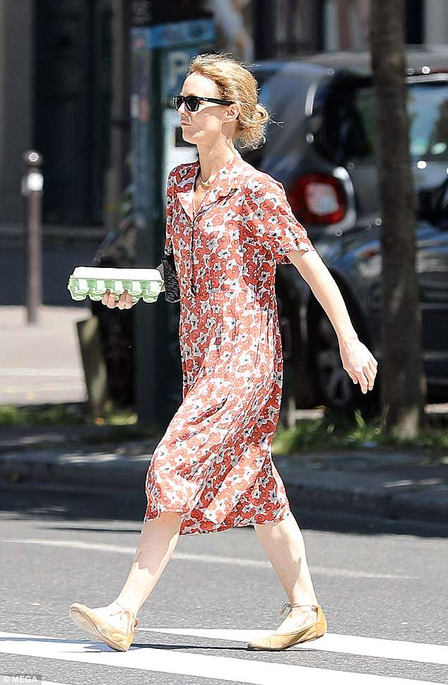 Casual: The actress, 45, swathed her lithe frame in a red and blue floral patterned dress as she was spotted heading home with some eggs and baguettes