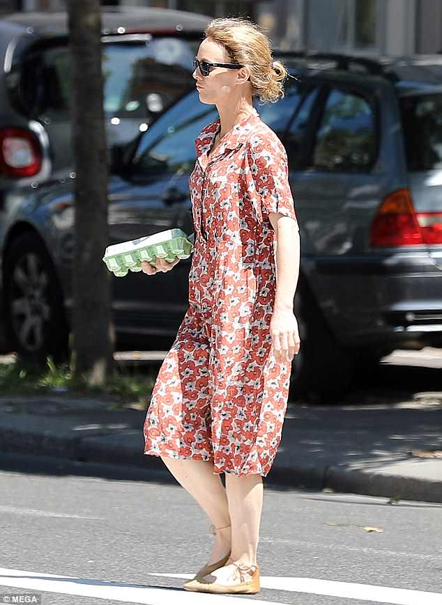Out and about: The star appeared to go make-up free, but hid her pretty features behind dark shades as she stepped out in the sunny French capital