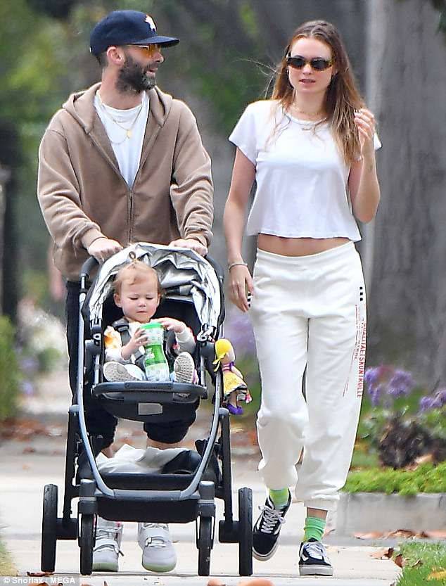 Family day: Behati Prinsloo brought her firstborn Dusty Rose out for a Los Angeles walk on Saturday, accompanied by her singing star husband Adam Levine