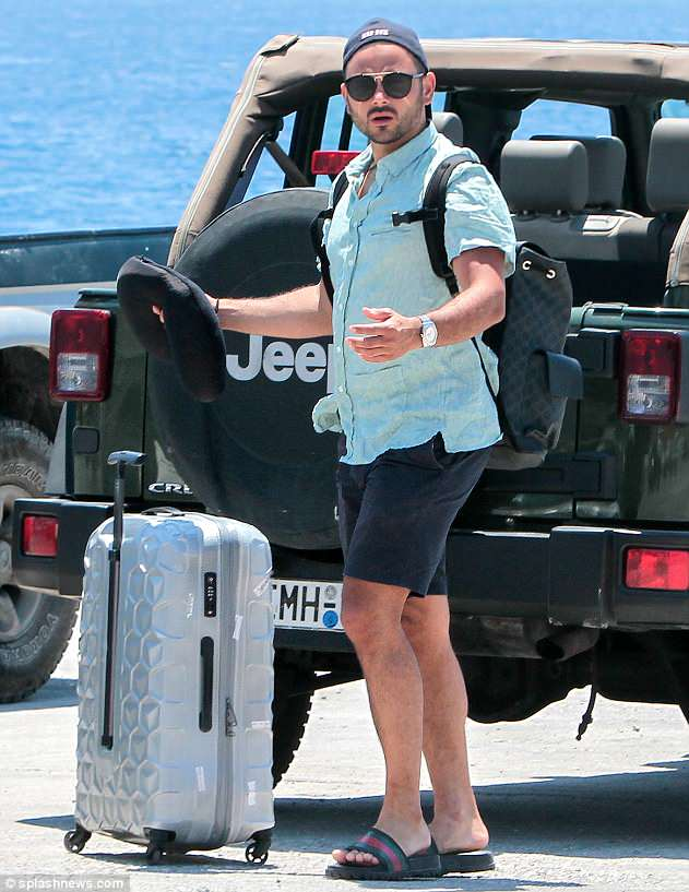 Onto the next adventure: As the pair arrived at the harbour, Ryan wore a colourful turquoise shirt, teamed with shorts and sliders