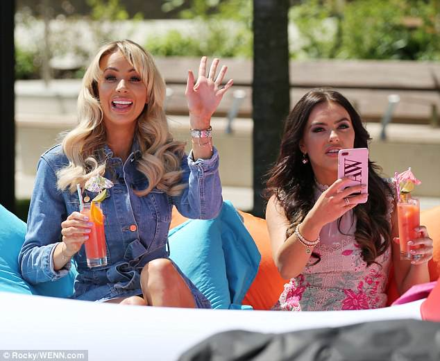 Say cheese! Rosie embarked on the al-fresco interview with 2017 Love Island star Olivia Attwood (L)
