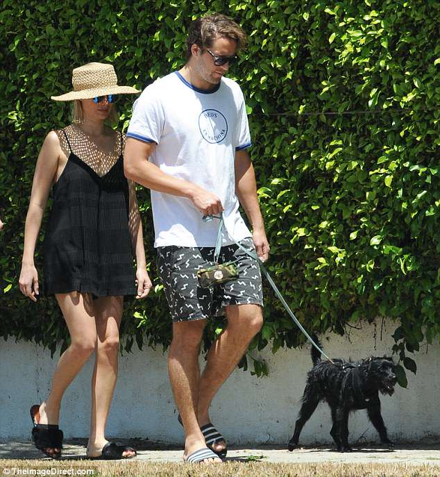 Out with their fur baby: Margot Robbie and husband Tom Ackerley were spotted taking their rescue pup, Boo Radley, for a walk in sunny Los Angeles on Sunday