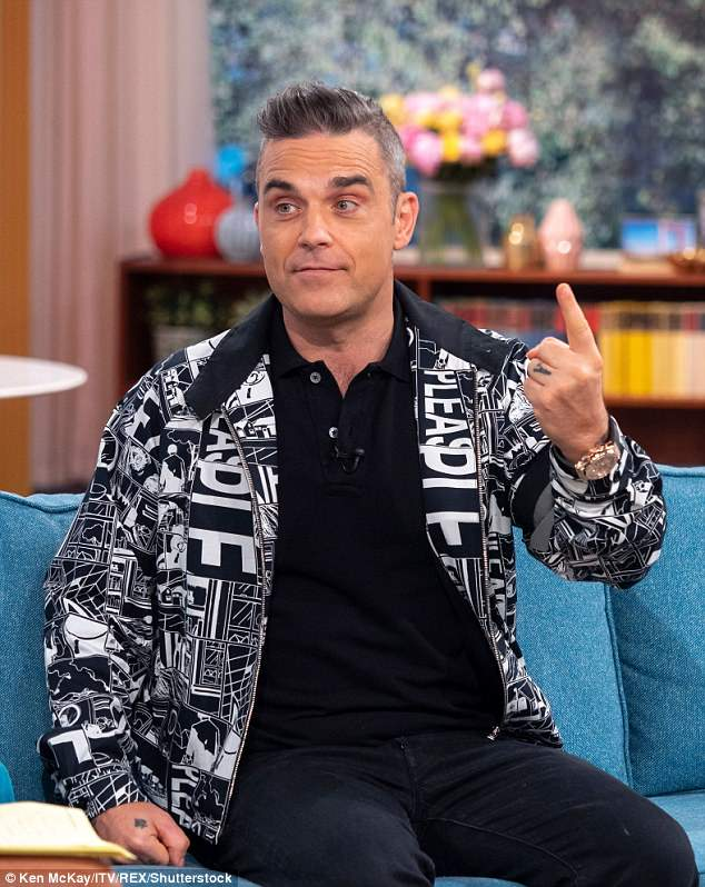 Giving nothing away: Robbie has also refused to confirm or deny  the rumours - he has been a regular guest performer on the show in previous series