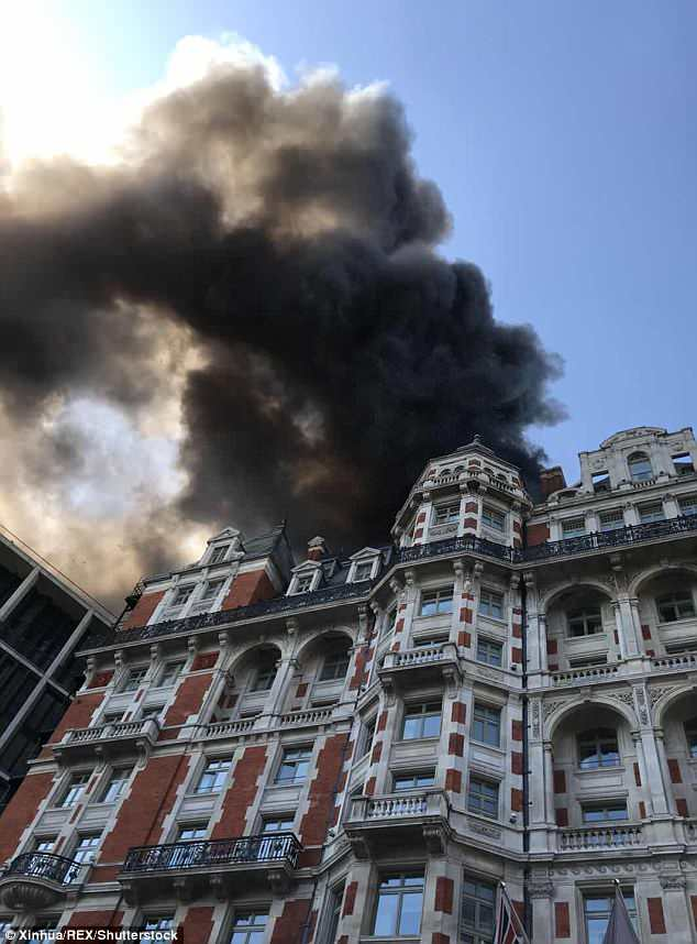 SOS! Ayda said she was naked when clouds of black smoke are pictured emerging from the Mandarin Oriental Hotel in Knightsbridge, central London when it caught fire on June 6