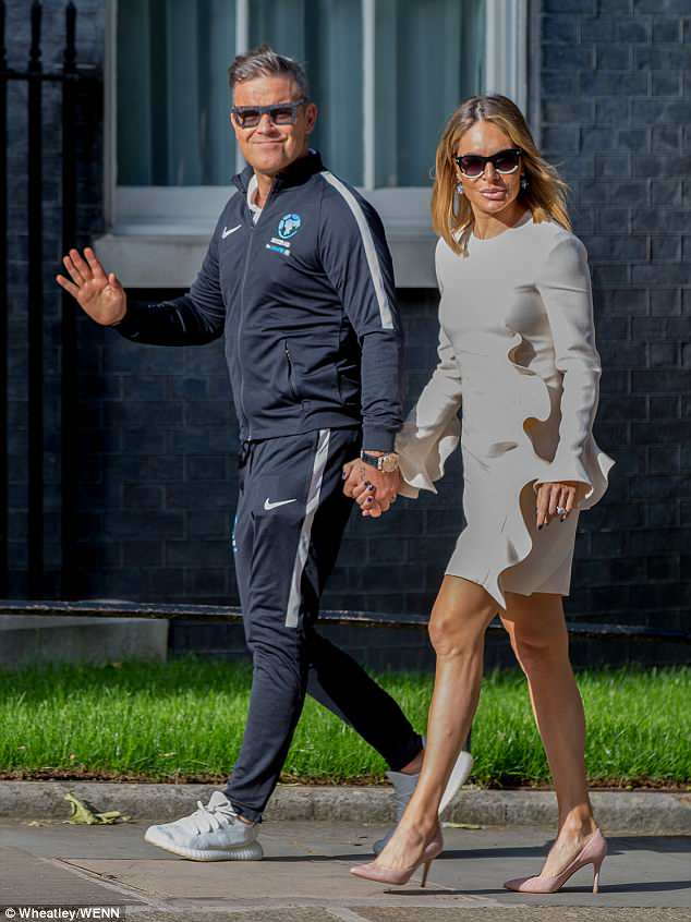 All OK: Robbie and Ayda were pictured attending a Downing Street reception for Soccer Aid a day after after escaping the fire