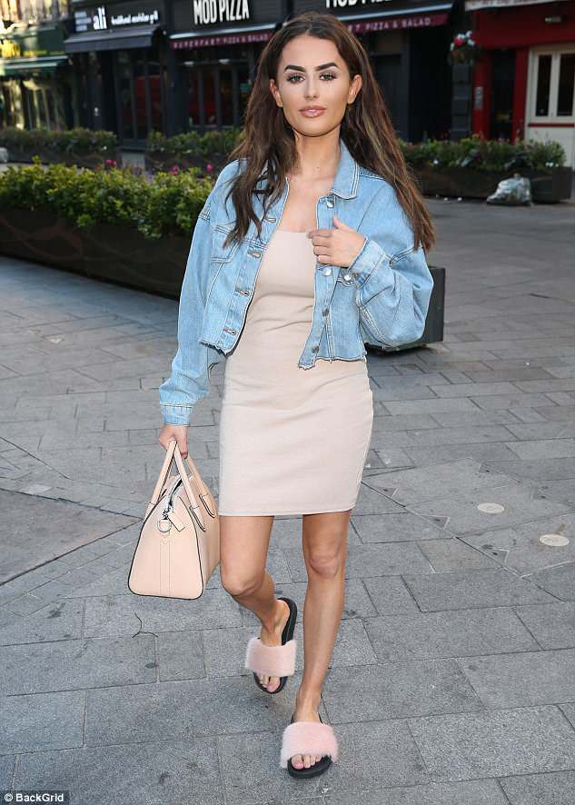 Style savvy: Aside from her admission, the petite TV star showcased her lithe frame in a beige mini dress as she arrived to Global studios in London earlier in the morning