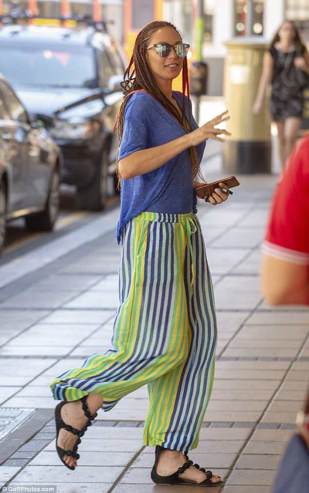 Birthday girl: The model ensured all eyes were on her as she donned a pair of bright wide-leg trousers, adorned with white, blue and green stripes throughout