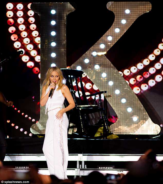 Leading lady: The stage was adorned with a huge light-up K as she sang