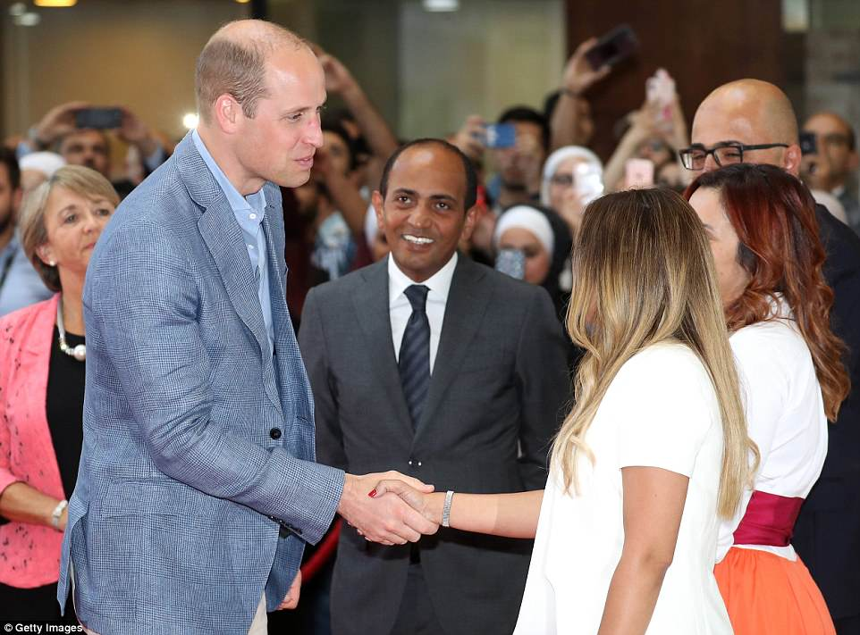 Prince William shakes hands as he visits vocational training college Al Quds, which has links to Middlesex University