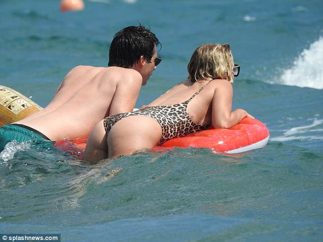 Relaxed: The duo looked completely relaxed as they floated out to sea