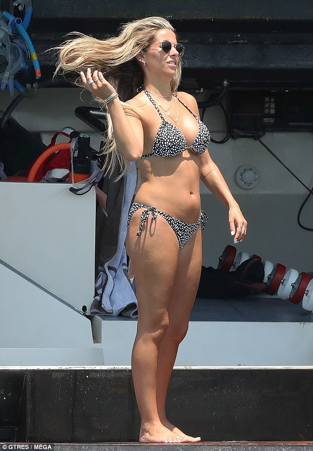Itsy bitsy: Anouska had all eyes on her as she stepped out in ablack patterned string bikini