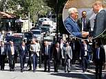 William is escorted by a security detail as he makes his way to a cultural event as part of his official tour in Ramallah today