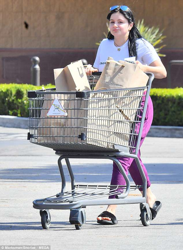 Running errands: The 20-year-old actress turned heads as she gave onlookers a sizzling peek at her toned midsection in a form-fitting slogan tee emblazoned with the words 'crowd pleaser'