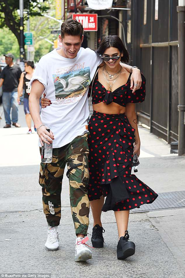 Still going strong: The musician and her boyfriend Isaac Carew hit back at cheating rumours earlier this month after he was pictured dancing with a mystery girl (pictured on June 18)