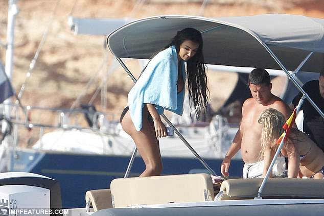 Yacht a day! The reality star clutched onto her iPhone when she climbed back aboard the yacht during her fun-filled outing