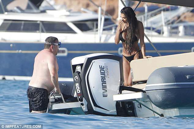 Chilled out: The television personality made the most of her sun-drenched trip when she chatted to her pal from the boat