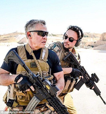With his father King Abdullah on militarymanoeuvres