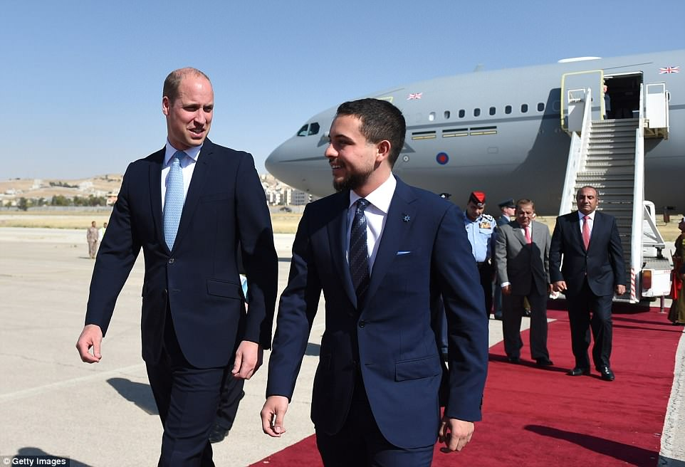 Prince William is greeted byCrown Prince Hussein bin Abdullah after touching down in Amman, Jordan's capital