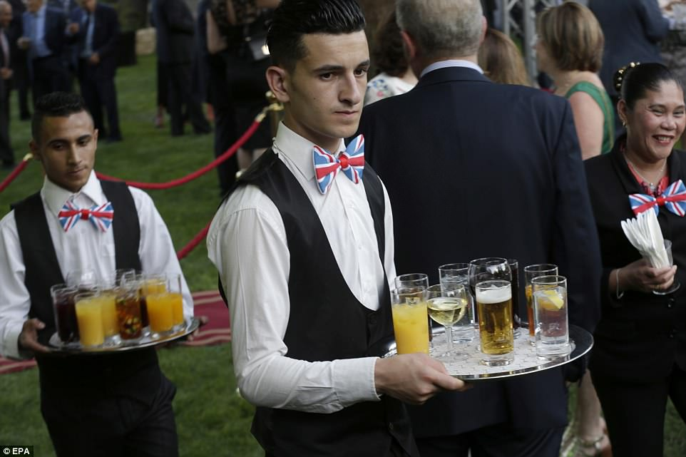 Waiters wearing Union Jack-themed dicky bows at the lavish evening reception at the British Embassy in Amman, Jordan