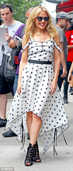 Wow: The Loco-Motion hitmaker, 50, nailed daytime glamour as she wandered through the streets of the Big Apple in the eye-catching number