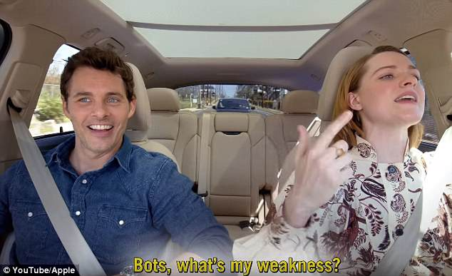 Beaming: As Evan took to the wheel, the pair cruised in the car while performing their best renditions of the classic hits