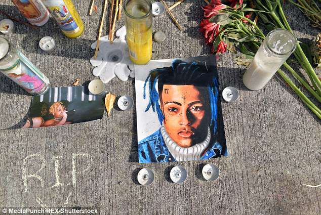 Dedication:The rapper - who was fatally shot in what police believe was a 'possible robbery' - knew weeks ago that his girlfriend - an unidentified woman - was pregnant