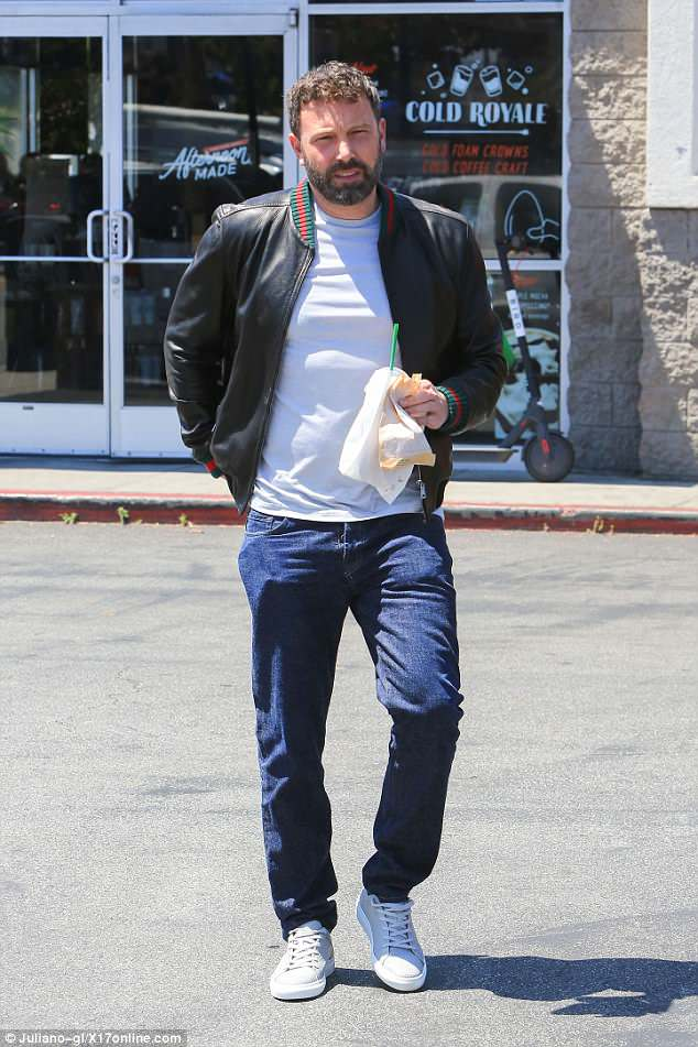 Burning sensation: Ben Affleck could not stop scratching his tattoo on Tuesday