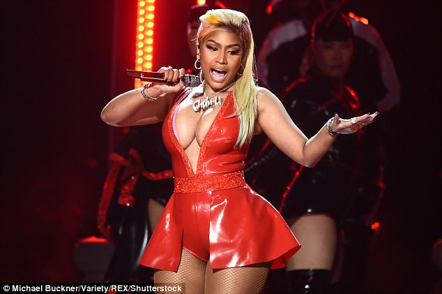 Nicki donned a bold red latex bodysuit for part of her incredible performance; the figure revealing look had a plunging neckline