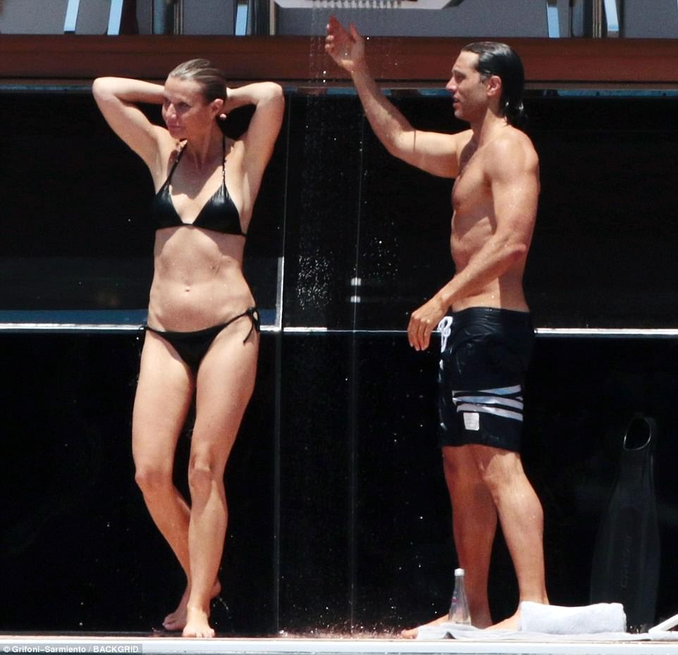 Still a cover girl: Gwyneth Paltrow proved on Sunday that her intense workouts with Tracy Anderson continue to pay off as she looked incredible in a small black bikini in Capri, Italy with fiance Brad Falchuk