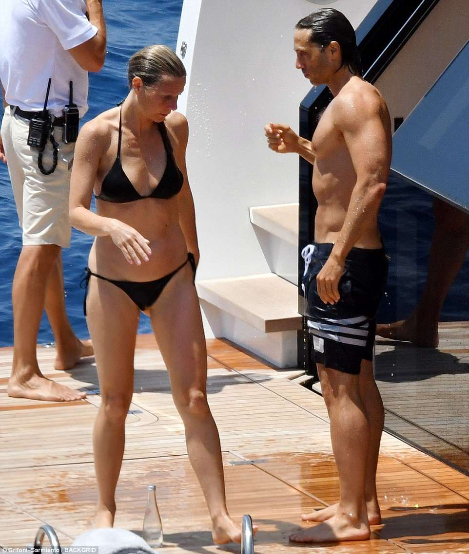 Toned, tanned and terrific: Paltrow did not disappoint as she made the most of a triangle bikini top with very small string bikini briefs. Her future husband had on black board shorts and looked buff as well making it likely that they work out together